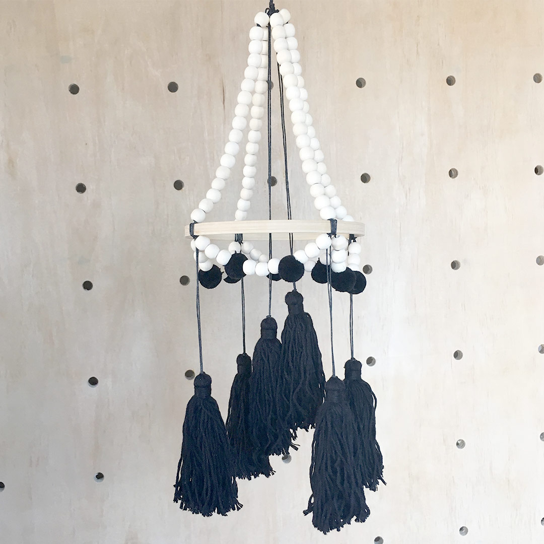 7e1311afbf Black Tassel Mobile by Tiger Lily
